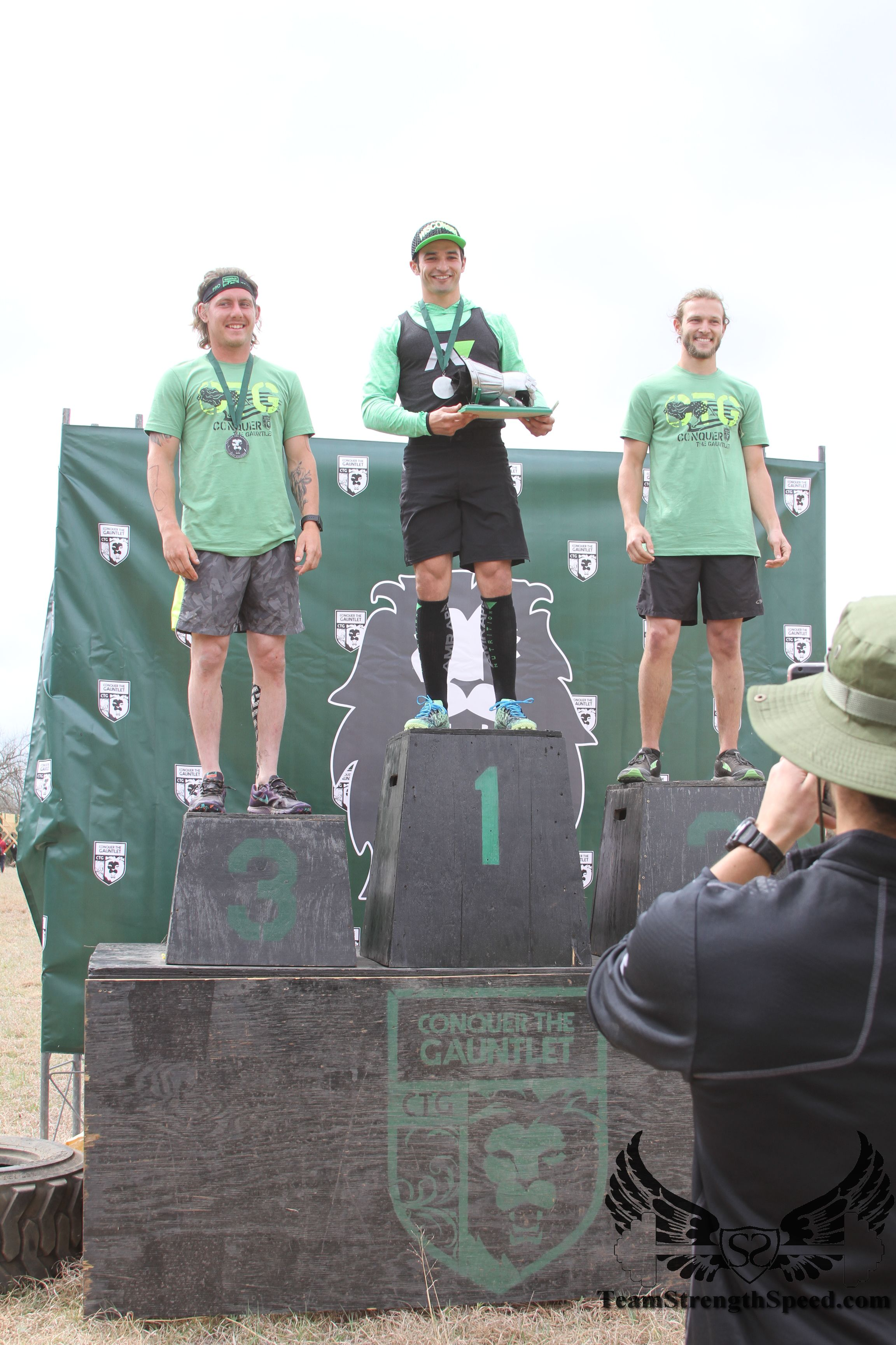 Cody Peyton (3rd), Jordan Buscemi (1st) and Bryce Robinson (2nd) stand on top of the podium. Jordan walking away with the metal Gauntlet showing his overall victory.