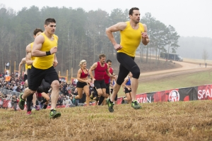"""SPARTAN: ULTIMATE TEAM CHALLENGE -- Episode 101 -- Pictured: (l-r) Ben Greenfield, Matt Anderson of """"Wedding Ringers""""; Stephanie Keenan, Adam Von Ins, Stephen Siraco of """"Charleston Warriors""""; Jonathan Burns of """"Wedding Ringers"""" head up the hill in heat one -- (Photo by: Mark Hill/NBC)"""