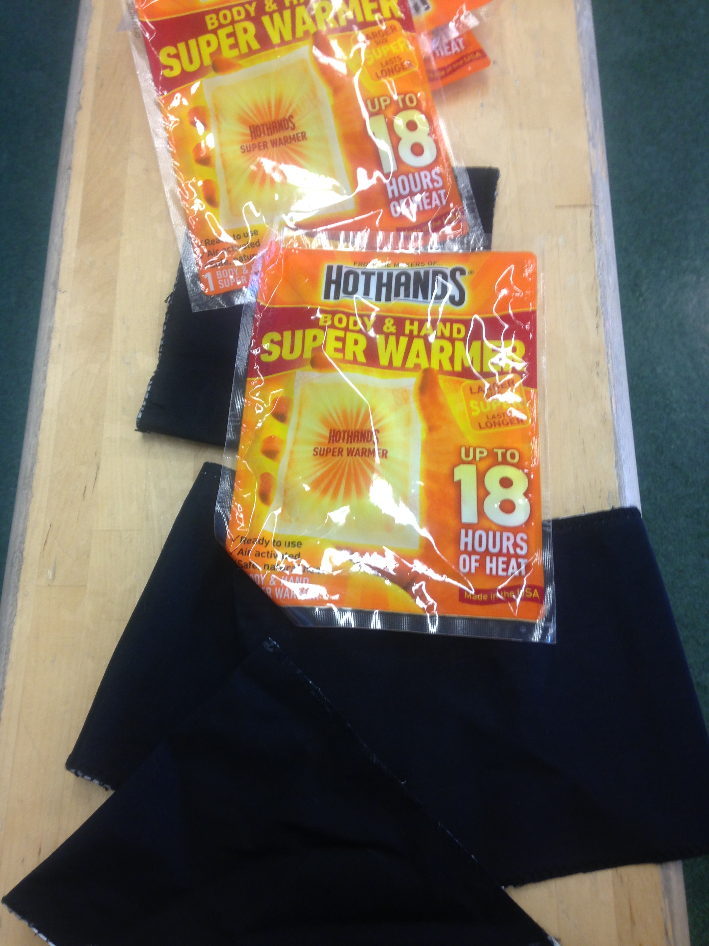 Prototype showing the cloth pouches and heat pads that are inserted in the cloth pouches.
